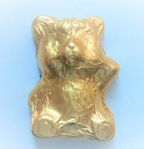 Bär Balu aus Schokolade gold, Ihre Genuss-Agentur
